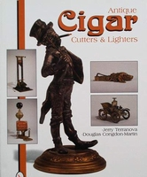 Antique Cigar Cutters and Lighters